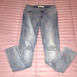 Medium-wash distressed jeans. I take offers.